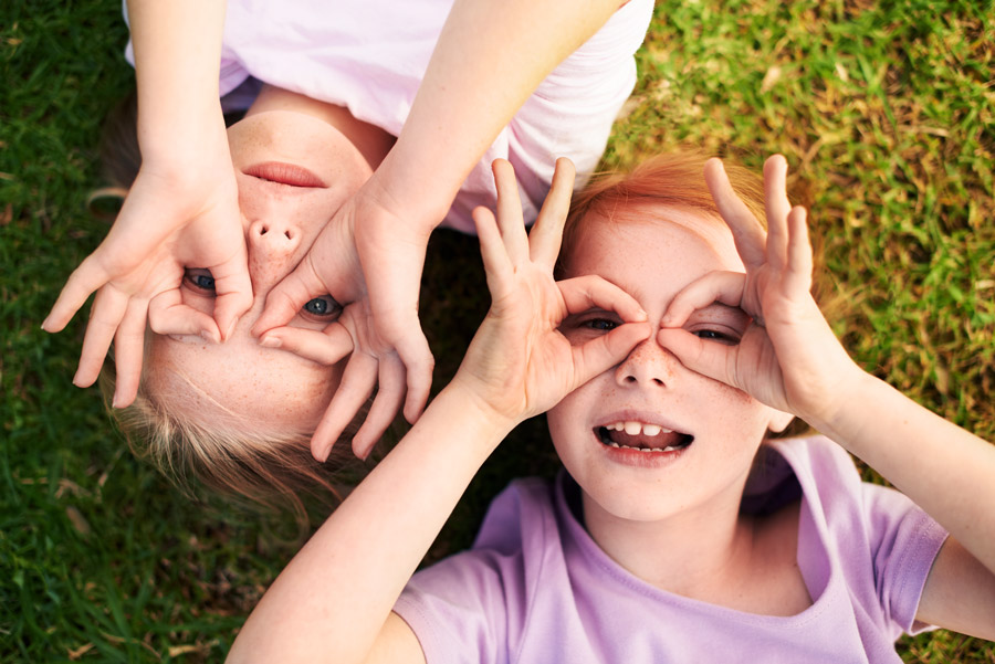 Two happy children having fun while highlighting the importance of eye and eyelid hygiene in children